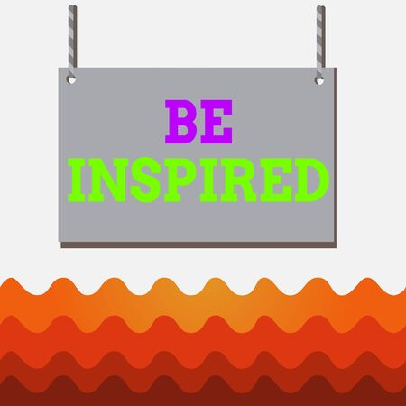 Conceptual hand writing showing Be Inspired. Concept meaning give oneself the desire or enthusiasm to do something well Wooden board wood empty frame fixed colorful striped string