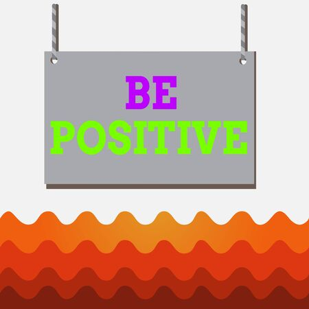 Conceptual hand writing showing Be Positive. Concept meaning giving cause for hope and confidence Without any doubt Wooden board wood empty frame fixed colorful striped string