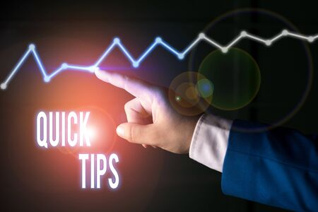 Writing note showing Quick Tips. Business concept for small but particularly useful piece of practical advice