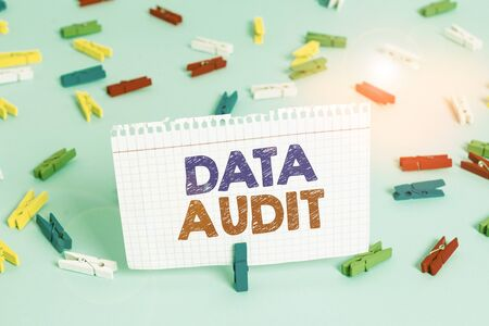 Writing note showing Data Audit. Business concept for auditing of data to assess its quality for a specific purpose Colored clothespin papers empty reminder blue floor officepin