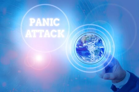 Writing note showing Panic Attack. Business concept for sudden periods of intense fear that may include palpitations Elements of this image furnished by NASA