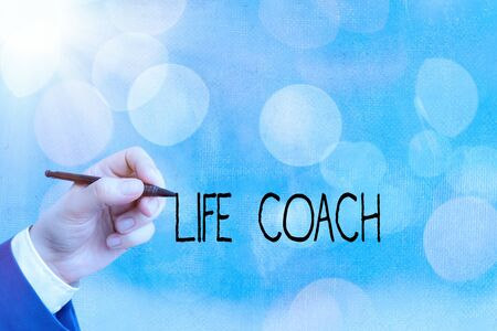 Conceptual hand writing showing Life Coach. Concept meaning someone who helps identify your goals and plan to achieve them Imagens