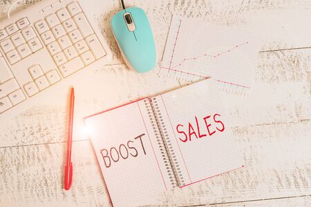 Text sign showing Boost Sales. Business photo text move sales profit from a lower to a higher place or position Wood desk office appliance computer equipaments chart numbers paper slot