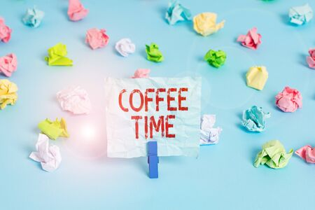Handwriting text Coffee Time. Conceptual photo a short period of time in which you stop working to rest Colored crumpled papers empty reminder blue floor background clothespin