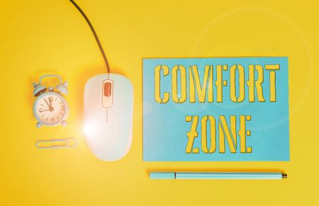 Handwriting text writing Comfort Zone. Conceptual photo place or situation where one feels safe and without stress Paper sheet alarm clock clip wire mouse gadget pencil colored background Banco de Imagens