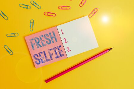 Word writing text Fresh Selfie. Business photo showcasing take a picture of yourself with no makeup filter or edit Colored square blank sticky notepads pencil clips plain color background 写真素材 - 143232730