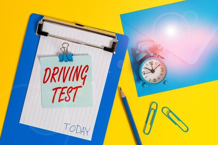 Writing note showing Driving Test. Business concept for procedure to test a demonstrating s is ability to drive a motor vehicle Clipboard sheet note pencil clips clock envelop colored background