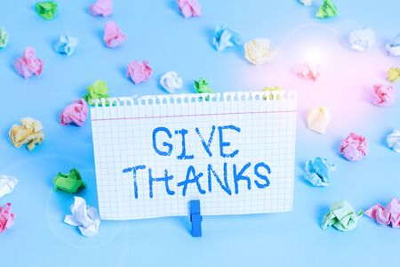 Conceptual hand writing showing Give Thanks. Concept meaning express gratitude or show appreciation Acknowledge the kindness Colored crumpled papers empty reminder blue floor clothespin