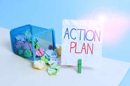 Text sign showing Action Plan. Business photo showcasing the detailed plan outlining actions needed to reach goals Trash bin crumpled paper clothespin empty reminder office supplies tipped