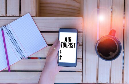 Writing note showing Air Tourist. Business concept for process of going from place to place by any flying object