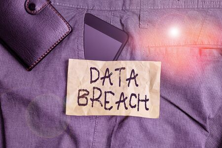Writing note showing Data Breach. Business concept for incident in which sensitive or confidential data is copied Smartphone device inside trousers front pocket with wallet