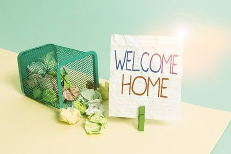 Text sign showing Welcome Home. Business photo showcasing a reception usually celebrate the return home of a demonstrating Trash bin crumpled paper clothespin empty reminder office supplies tipped 版權商用圖片