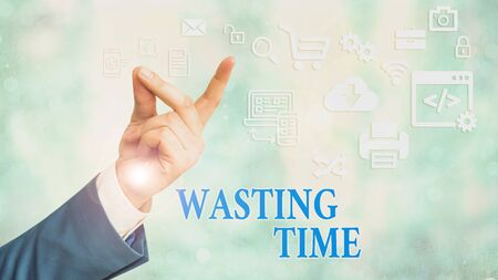 Text sign showing Wasting Time. Business photo showcasing act of spending time doing something that is unnecessary