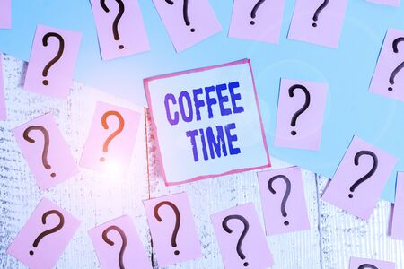 Conceptual hand writing showing Coffee Time. Concept meaning a short period of time in which you stop working to rest Crumbling papers with thick cardboard on the wooden table