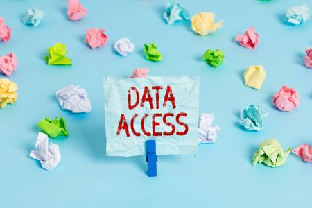 Handwriting text Data Access. Conceptual photo a user s is ability to access data stored within a database Colored crumpled papers empty reminder blue floor background clothespin
