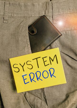 Writing note showing System Error. Business concept for instruction that is not recognized by an operating system Small wallet inside trouser front pocket near notation paper