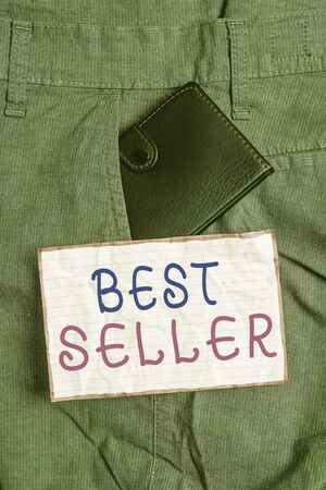 Text sign showing Best Seller. Business photo text new book or other product that has sold a great number of copies Small little wallet inside man trousers front pocket near notation paper