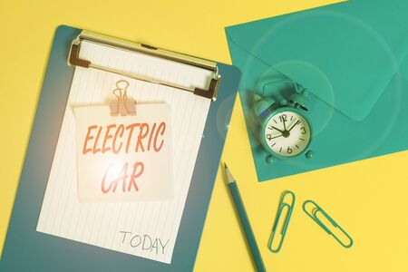 Writing note showing Electric Car. Business concept for an automobile that is propelled by one or more electric motors Clipboard sheet note pencil clips clock envelop colored background