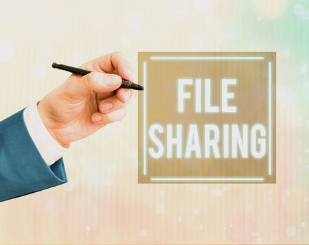 Conceptual hand writing showing File Sharing. Concept meaning transmit files from one computer to another over a network Foto de archivo