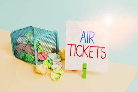 Text sign showing Air Tickets. Business photo showcasing individual is entitled to a seat on a flight on an aircraft Trash bin crumpled paper clothespin empty reminder office supplies tipped