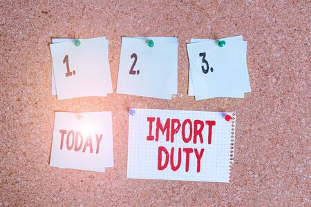 Writing note showing Import Duty. Business concept for tax imposed by a government on goods from other countries Corkboard size paper thumbtack sheet billboard notice board Standard-Bild