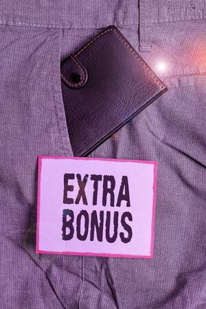 Text sign showing Extra Bonus. Business photo text an extra amount of money that is added to someone s is pay Small little wallet inside man trousers front pocket near notation paper
