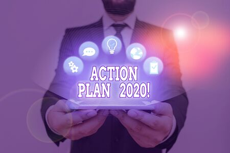 Conceptual hand writing showing Action Plan 2020. Concept meaning proposed strategy or course of actions for current year Reklamní fotografie