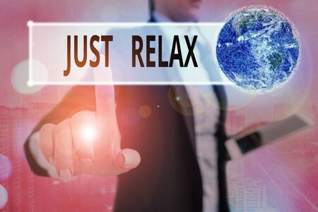 Writing note showing Just Relax. Business concept for to rest or do something that is enjoyable and stress free