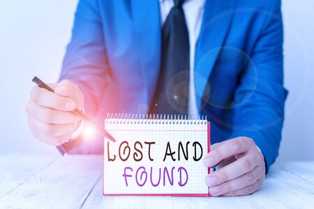 Handwriting text writing Lost And Found. Conceptual photo a place where lost items are stored until they reclaimed Man holds empty paper with copy space in front of him Space