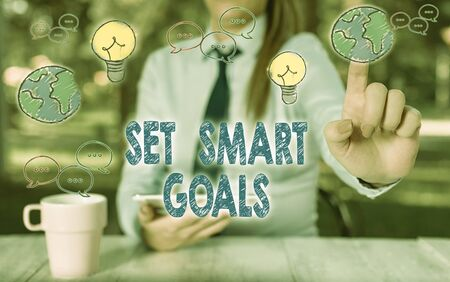 Writing note showing Set Smart Goals. Business concept for list to clarify your ideas focus efforts use time wisely