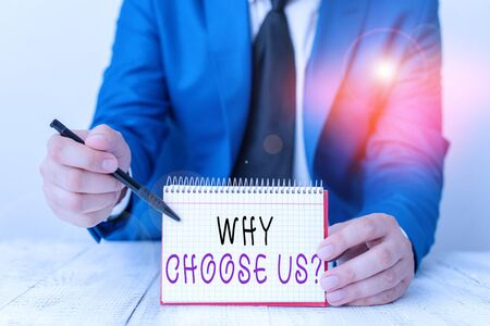 Handwriting text writing Why Choose Us Question. Conceptual photo list of advantages and disadvantages to select product service Man holds empty paper with copy space in front of him Space Zdjęcie Seryjne