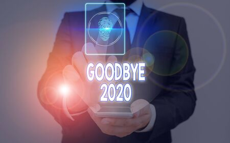 Writing note showing Good Bye 2020. Business concept for express good wishes when parting or at the end of last year