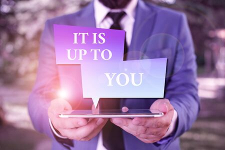 Word writing text It Is Up To You. Business photo showcasing Used to tell a demonstrating that they are the one to decide Businessman in blue suite with a tie holds lap top in hands Imagens