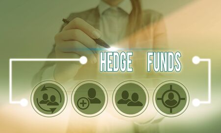 Conceptual hand writing showing Hedge Funds. Concept meaning basically a fancy name for an alternative investment partnership