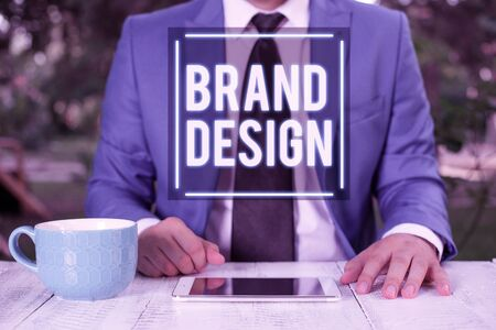 Writing note showing Brand Design. Business concept for visual elements that make up the corporate or brand identity Businessman with pointing finger in front of him