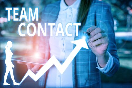 Conceptual hand writing showing Team Contact. Concept meaning The interaction of the individuals on a team or group