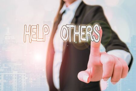 Writing note showing Help Others. Business concept for the action of helping someone to do something or assistance