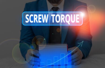 Writing note showing Screw Torque. Business concept for measure of the twisting force required to spin the nut