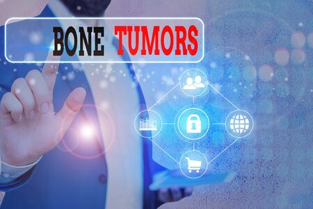 Writing note showing Bone Tumors. Business concept for can be either benign or malignant growths found in the bone Banco de Imagens