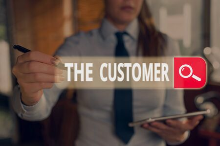 Writing note showing The Customer. Business concept for demonstrating or organization that buys goods or services from a store Stock Photo