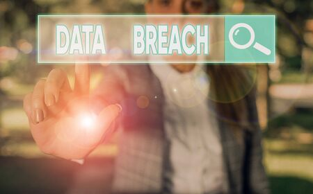 Writing note showing Data Breach. Business concept for incident in which sensitive or confidential data is copied