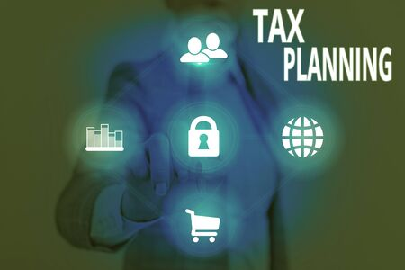 Writing note showing Tax Planning. Business concept for man of financial situation or plan from a tax perspective