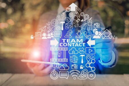 Writing note showing Team Contact. Business concept for The interaction of the individuals on a team or group