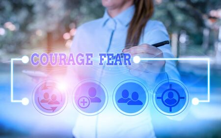 Writing note showing Courage Fear. Business concept for quality of mind that enables a demonstrating to face difficulty