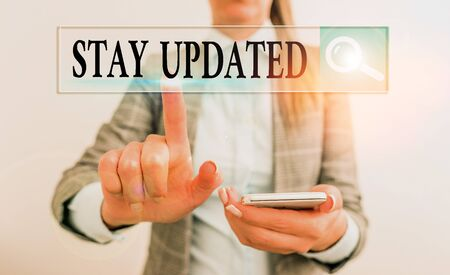 Writing note showing Stay Updated. Business concept for keep modern recent or containing the latest information