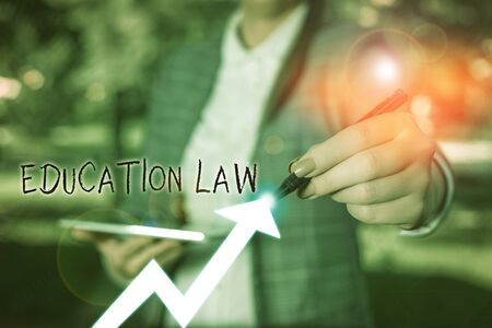Writing note showing Education Law. Business concept for legal discipline covering all issues pertaining to schools