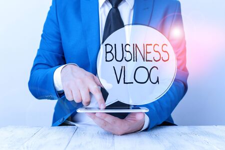 Handwriting text Business Vlog. Conceptual photo A video content about subject matter related to the company Businessman with pointing finger in front of him
