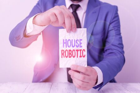 Word writing text House Robotic. Business photo showcasing Programmable powered machines that perform household chores Man holds empty paper with copy space in front of him Copy Space