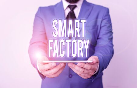Word writing text Smart Factory. Business photo showcasing A highly digitized and connected production facility Businessman in blue suite with a tie holds lap top in hands