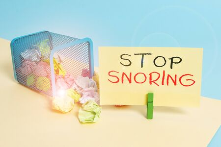 Handwriting text writing Stop Snoring. Conceptual photo noisy breathing during sleep due to vibrating airway tissue Trash bin crumpled paper clothespin empty reminder office supplies tipped